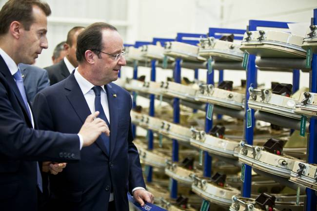Airbus Helicopters President Guillaume Faury takes French President Francois Hollande on a tour of the Querétaro site